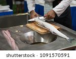 fresh fish cutting and prepare... | Shutterstock . vector #1091570591