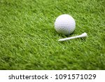 golf ball and tee are on green... | Shutterstock . vector #1091571029