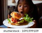 asian child girl holding dish...   Shutterstock . vector #1091599109