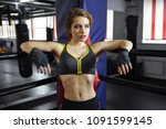 sexy boxing girl stands leaned... | Shutterstock . vector #1091599145