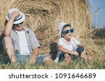 father and son sitting in the... | Shutterstock . vector #1091646689