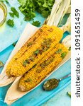Small photo of Serving grilled corn in husk with pesto and lime and herbs.