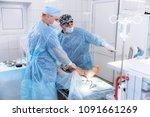 a team of doctors in the... | Shutterstock . vector #1091661269