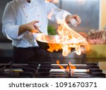 chef cooking and doing flambe... | Shutterstock . vector #1091670371
