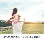 little girl sitting on father's ... | Shutterstock . vector #1091671064