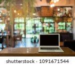 blank screen laptop on table in ... | Shutterstock . vector #1091671544