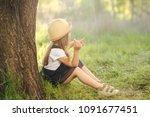 toddler girl on countryside | Shutterstock . vector #1091677451