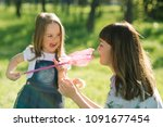 mother and daughter summer... | Shutterstock . vector #1091677454