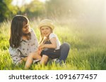 candid loving family of mother... | Shutterstock . vector #1091677457
