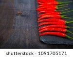 red chilli pepper is a dark...   Shutterstock . vector #1091705171