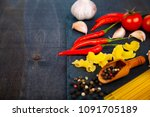 different pasta on a dark ...   Shutterstock . vector #1091705189