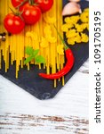 different pasta on a  wooden...   Shutterstock . vector #1091705195