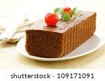 chocolate birthday cake with cherries and mint - stock photo