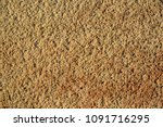 Small photo of Texture of dark yellow solid silica sand, background