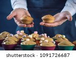 chef pastry in a black apron...   Shutterstock . vector #1091726687