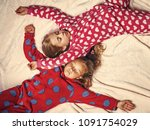 girls in pajamas sleep in bed ... | Shutterstock . vector #1091754029