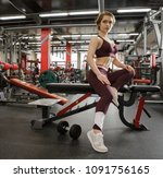 the girl in the gym with a... | Shutterstock . vector #1091756165