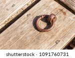 old rusty metal dock ring on a... | Shutterstock . vector #1091760731
