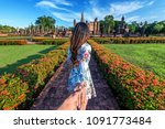 woman holding man's hand and... | Shutterstock . vector #1091773484