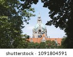 Stock photo tower of new city hall in hannover germany framed by trees 1091804591