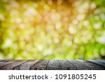 empty wooden table with bokeh... | Shutterstock . vector #1091805245
