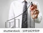businessman drawing graphics a... | Shutterstock . vector #1091829509