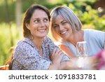 portrait of two beautiful women ... | Shutterstock . vector #1091833781