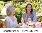 portrait of two beautiful women ... | Shutterstock . vector #1091833799