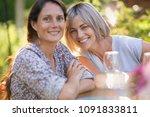 portrait of two beautiful women ... | Shutterstock . vector #1091833811