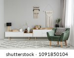 green armchair on patterned... | Shutterstock . vector #1091850104