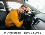 Stock photo man sits in his lovely car 1091851961
