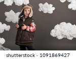 boy dressed as an airplane... | Shutterstock . vector #1091869427