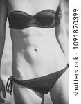 female body in black bikini... | Shutterstock . vector #1091870399