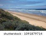 Long  Windswept Sandy Beach In...