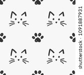 Stock vector cat faces and paws seamless pattern vector 1091887931