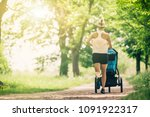 running woman with baby... | Shutterstock . vector #1091922317