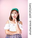 Small photo of Asian girls women short hair wearing white shirt and green head cover shows absolutely relieved. With the background is pink.