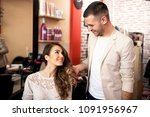 smiling hairdresser and... | Shutterstock . vector #1091956967