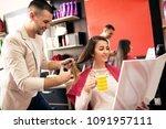 beautiful woman getting haircut ... | Shutterstock . vector #1091957111