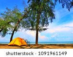 a sunny day at the beach with a ... | Shutterstock . vector #1091961149