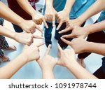 many people join together as a... | Shutterstock . vector #1091978744