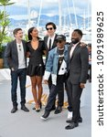 """Small photo of CANNES, FRANCE. May 15, 2018: Topher Grace, Laura Harrier, Adam Driver, Spike Lee & John David Washington at the photocall for """"Blackkklansman"""" at the 71st Festival de Cannes"""