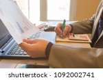 man hand with pen  calculator... | Shutterstock . vector #1092002741