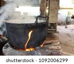Small photo of Old pot is set on fire.