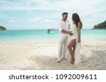 attractive young couple on the... | Shutterstock . vector #1092009611