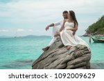 attractive young couple on the... | Shutterstock . vector #1092009629