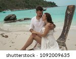 attractive young couple on the... | Shutterstock . vector #1092009635