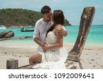 attractive young couple on the... | Shutterstock . vector #1092009641