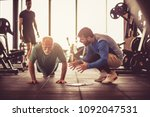 personal trainer working... | Shutterstock . vector #1092047531
