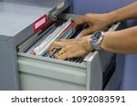 hand of man search files... | Shutterstock . vector #1092083591